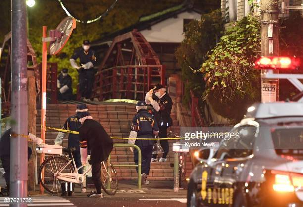 Police officers investigate the scene of a knife attack in Tokyo's Koto Ward on Dec 7 in which two men and two women were injured At around 830 pm...
