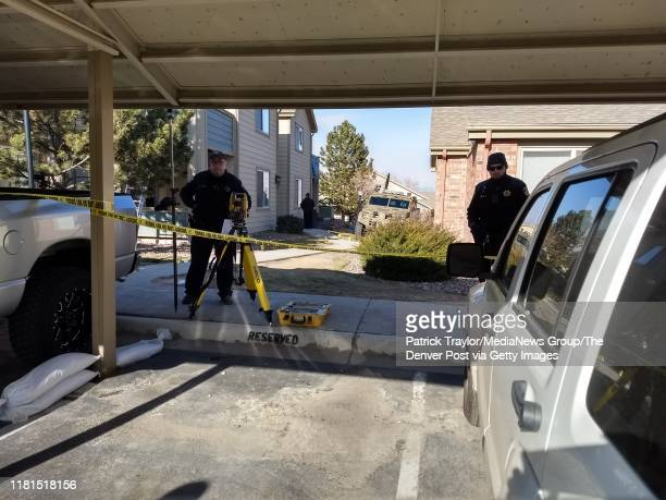 Police officers investigate the scene of an alleged ambush where one deputy was killed and four other wounded along with two civilians at the Copper...