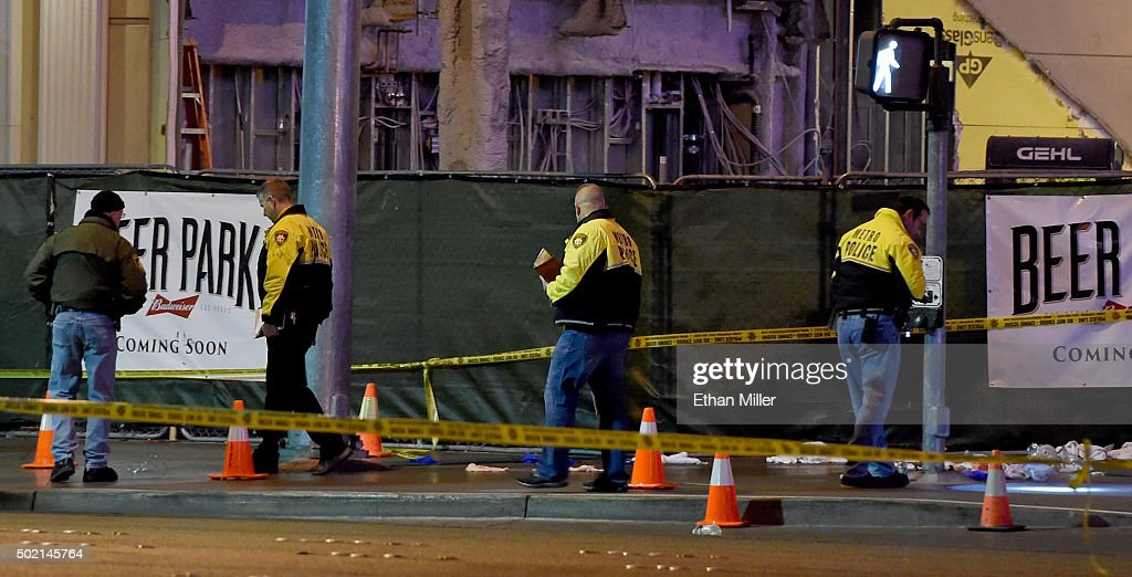 Police officers investigate the scene on the Las Vegas Strip in front of the Paris Las Vegas where a car crashed into a group of pedestrians on the sidewalk reportedly injuring at least 35 people and killing one on December 20, 2015 in Las Vegas, Nevada.