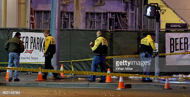 Police officers investigate the scene on the Las Vegas Strip in front of the Paris Las Vegas where a car crashed into a group of pedestrians on the...