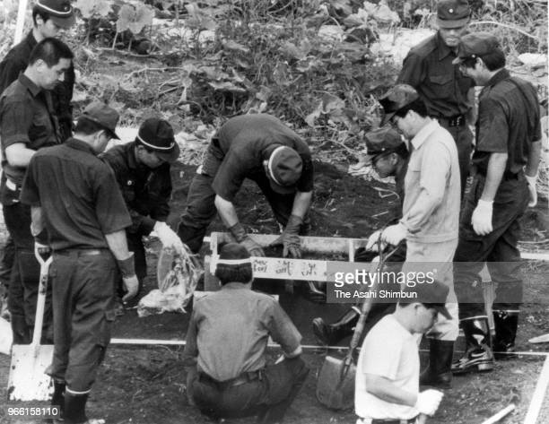 Police officers investigate the site where suspect TSutomu Miyazaki confessed that he had burnt bones of killed girl on August 6, 1989 in Itsukaichi,...
