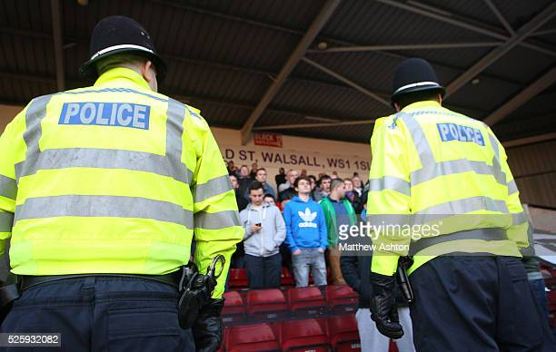 Police officers keep an eye on the fans at Bank's Stadium home of Walsall