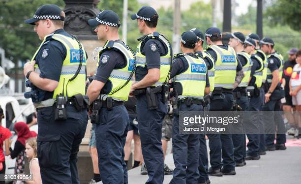 Police officers keep order as protestors gather at State Parliament on January 26 2018 in Melbourne Australia Australia Day formerly known as...
