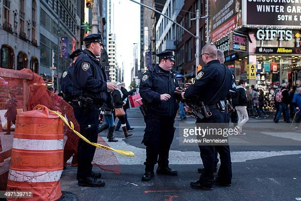 Police officers keep watch in Times Square following a series of terrorist attacks in Paris on November 14 2015 in New York City Security in New York...