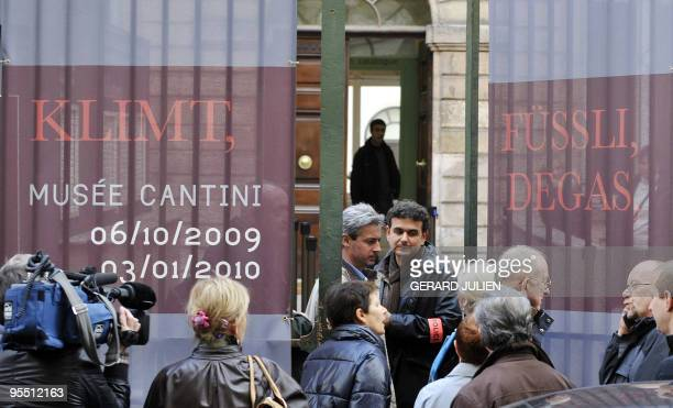 Police officers leave the Cantini Museum in Marseille southern France on December 31 2009 after a painting by 19th century artist Edgar Degas worth...