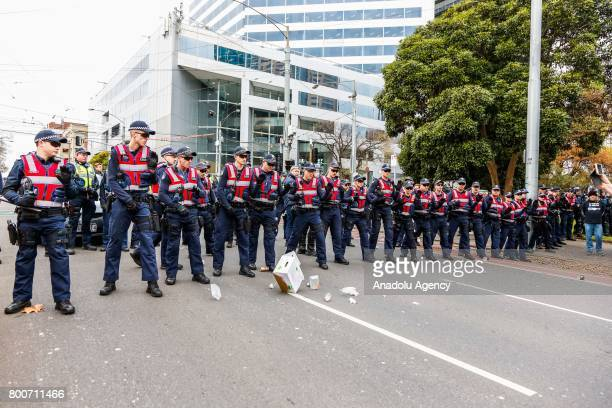 Police officers line cordon to stop protestors from clashing during a protest organised by the antiIslam True Blue Crew supported by the United...