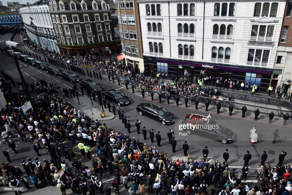 Police officers line the route in Southwark as the funeral procession of PC Keith Palmer makes its way to Southwark Cathedral, on April 10, 2017 in London, United Kingdom. A Full Force funeral is held for PC Keith Palmer who was killed in a terrorist attack in Westminster whilst on duty on March 22, 2017. The funeral is attended by his family, including his wife and child, and officers from the Metropolitan Police who served alongside him. Officers from the wider service across England and Wales also attend to honour their fallen colleague.
