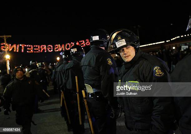 Police officers line up as they attempt to clear the street in front of the Ferguson police station on November 25 2014 in Ferguson Missouri Over...