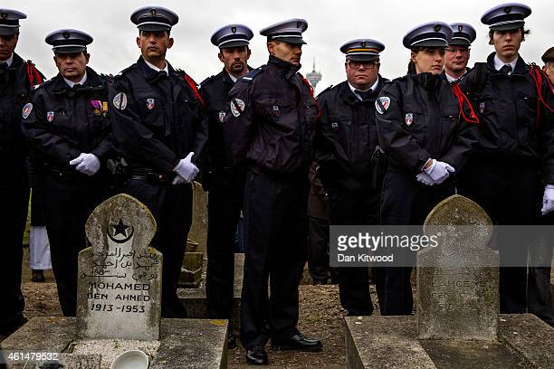 Police Officers line up at the funeral of murdered police officer Ahmed Merabet during the burial at a muslim cemetery on January 13 2015 in Bobigny...