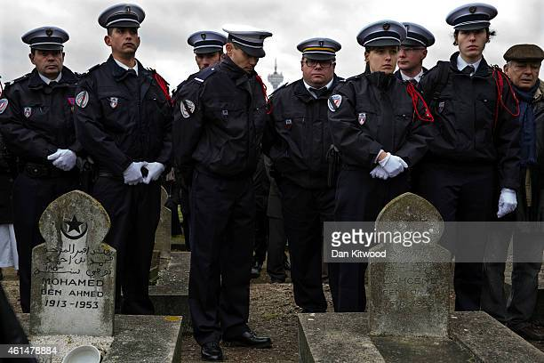 Police Officers line up at the funeral of the murdered police officer Ahmed Merabet during the burial at a muslim cemetary on January 13 2015 in...