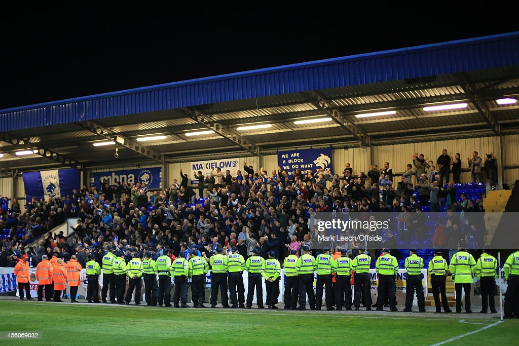 Police officers line up in front of the Chester fans during the Vanarama Conference match between Chester and Wrexham at the Deva Stadium on September 22, 2014 in Chester, England.