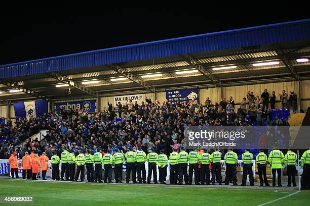 Police officers line up in front of the Chester fans during the Vanarama Conference match between Chester and Wrexham at the Deva Stadium on...