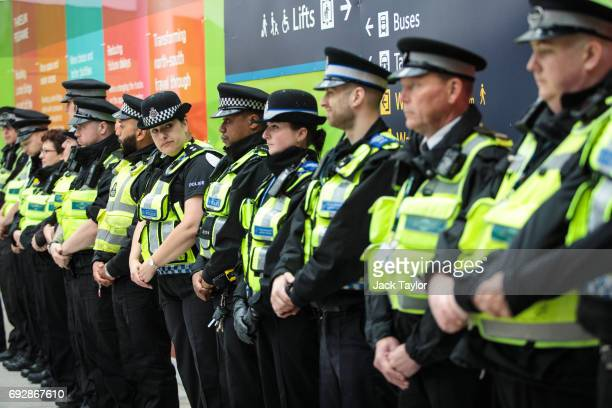 Police officers line up to observe a minute's silence for the victims of the June 3rd terror attacks at London Bridge Station on June 6 2017 in...