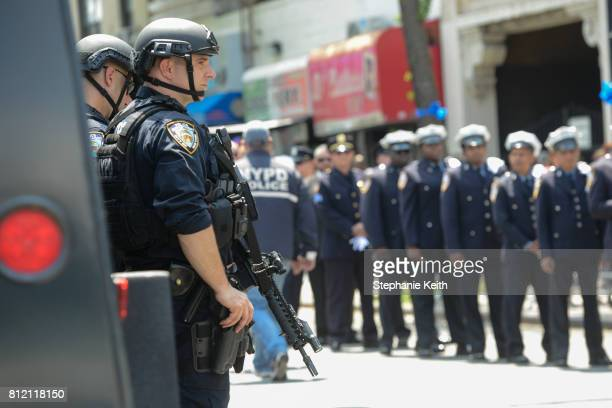 Police officers line up to pay respects to slain New York City police officer Miosotis Familia on July 10 2017 in the Bronx borough of New York City...