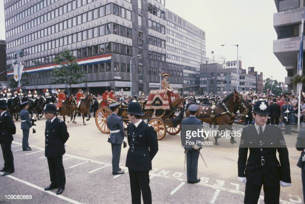 Police officers lining the procession route on they way to Buckingham Palace on the day of Prince Charles' wedding to Lady Diana Spencer, London,...