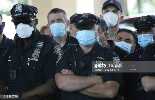Police officers listen as Police Benevolent Association of the City of New York President Pat Lynch and representatives from other NYPD and law...