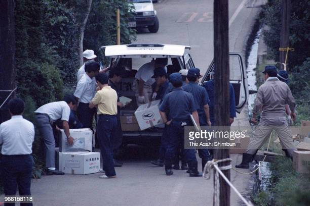Police officers load boxes of collected soil from where suspect TSutomu Miyazaki confessed that he had burnt bones of killed girl on August 6, 1989...