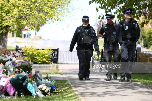 Police officers look at floral tributes for murdered PCSO Julia James on May 2, 2021 in Aylesham, England.The body of PCSO Julia James was discovered...