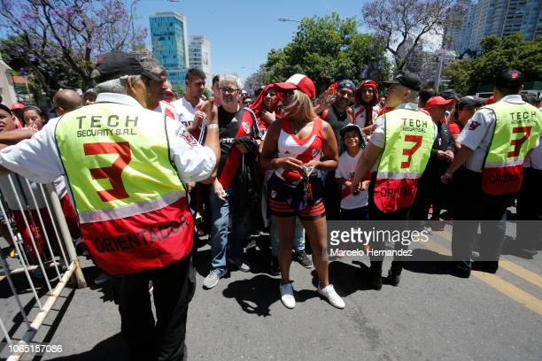 Police officers look at River fans on their way to the stadium before the second leg of the final of Copa CONMEBOL Libertadores 2018 between River...