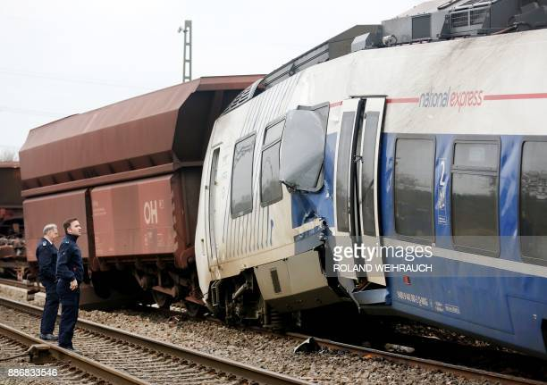 Police officers look at the wreckage on December 06 2017 on the site of a train accident in MeerbuschOsterath western Germany where a passenger train...