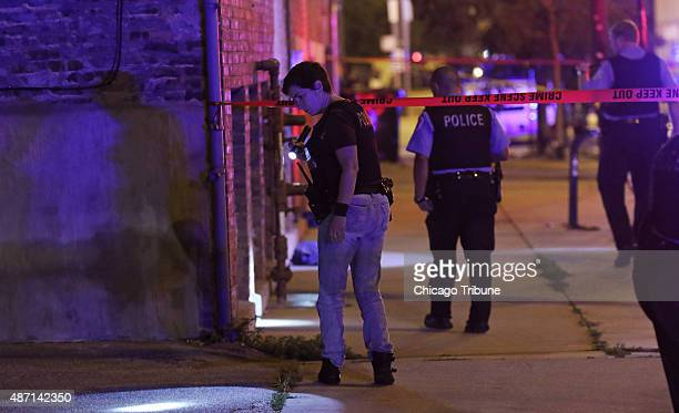 Police officers look for evidence at the scene of a double shooting on the 100 block of North Racine Avenue on Sunday Sept 6 in Chicago