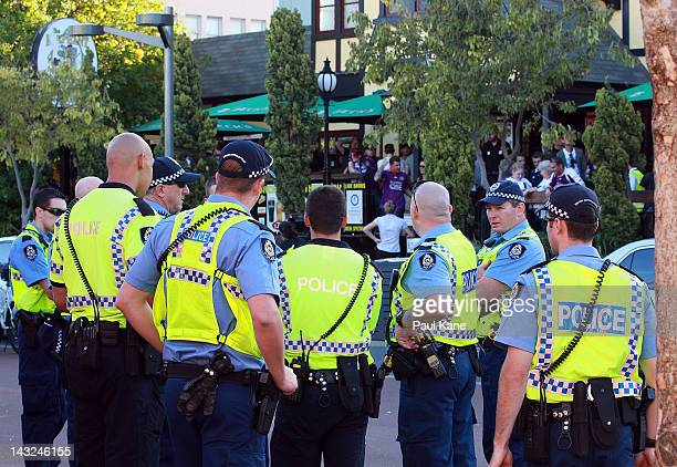 Police officers look on after trouble broke out between fans at the Elephant and Wheelbarrow pub after the ALeague Grand Final between the Brisbane...