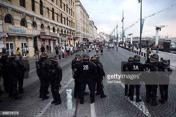 Police officers look on as England football fans block a street in Marseille on June 10 2016 in Marseille France Football fans from around Europe...