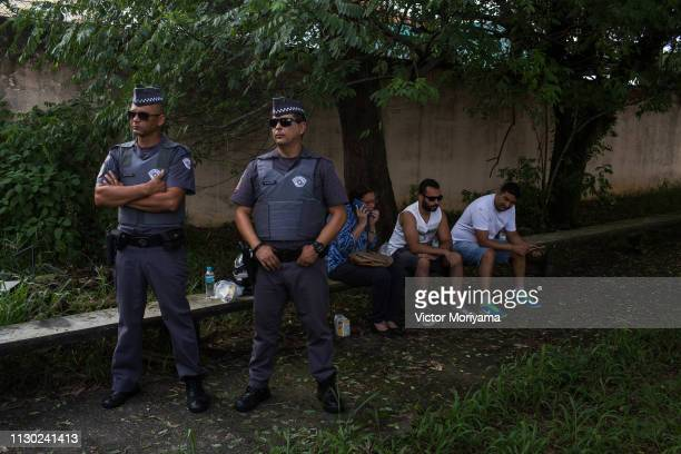 Police officers look on during a news conference following a shooting at a public school on March 13, 2019 in Suzano, Brazil. Eight people were...