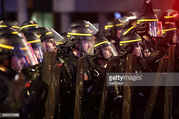 Police officers look on during a pause in clashes with England fans on June 16 2016 in Lille France Police used tear gas and pepper spray on the fans...