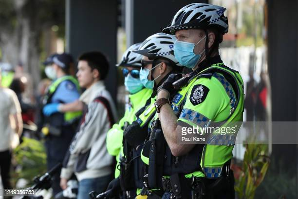 Police officers look on during the Black Lives Matter Rally at Langley Park on June 13, 2020 in Perth, Australia. The event was organised in...