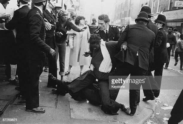 Police officers make an arrest on the second day of riots in Brixton London 13th April 1981