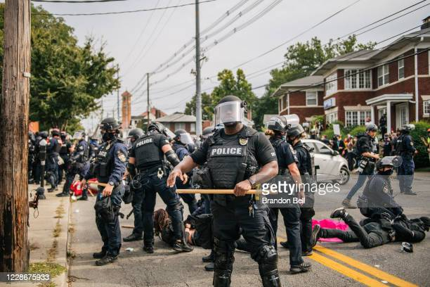 Police officers make arrests during protests on September 23, 2020 in Louisville, Kentucky. Protesters marched in the streets after a Kentucky Grand...