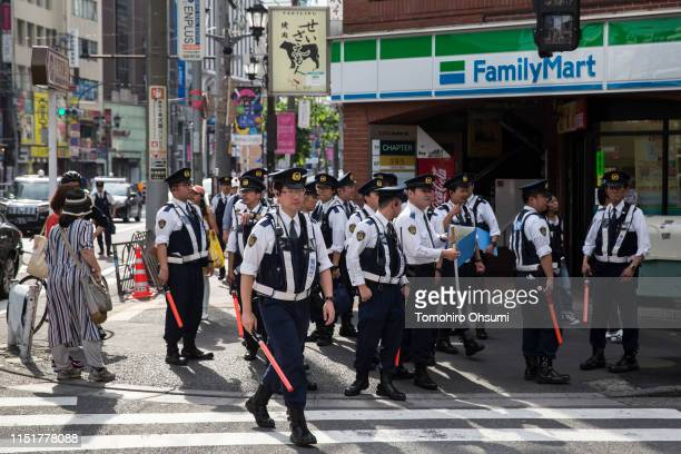 Police officers make final preparations before a motorcade carrying US President Donald Trump First Lady Melania Trump Japan's Prime Minister Shinzo...