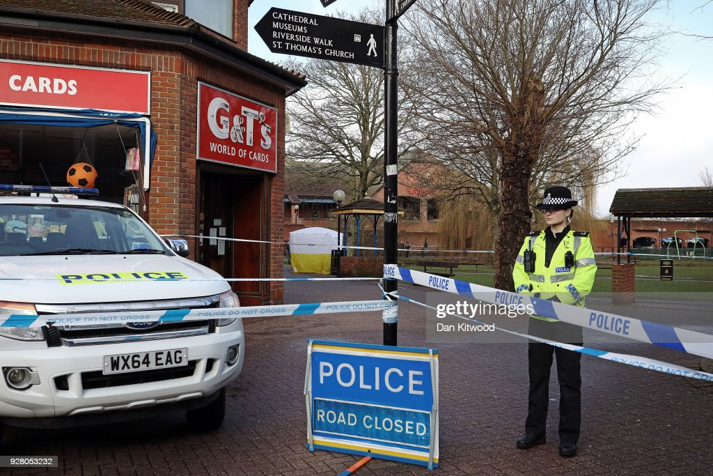 Police officers man a cordon near a forensic tent where Sergei Skripal, 66 and his duaghter Yulia Skripal, in her 30s, were found unconscious in Salisbury town centre two days previously on March 6, 2018 in Salisbury, England. Sergei Skripal who was granted refuge in the UK following a 'spy swap' between the US and Russia in 2010 and his daughter remain critically ill after being exposed to an 'unknown substance'.