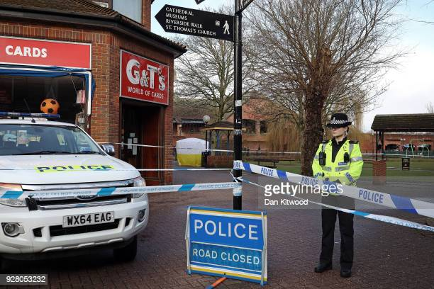 Police officers man a cordon near a forensic tent where Sergei Skripal 66 and his duaghter Yulia Skripal in her 30s were found unconscious in...