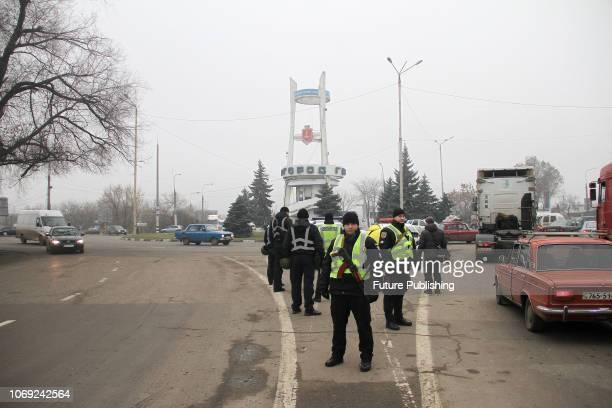 Police officers man a roadblock set up on the outskirts of Odesa southern Ukraine December 5 2018 Ukrinform