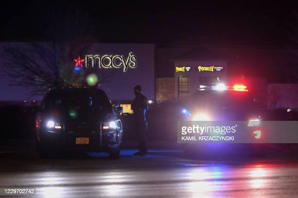 Police officers monitor the area outside the Mayfair Mall in Wauwatosa, Wisconsin, on November 20, 2020. - Multiple people were injured in a shooting...