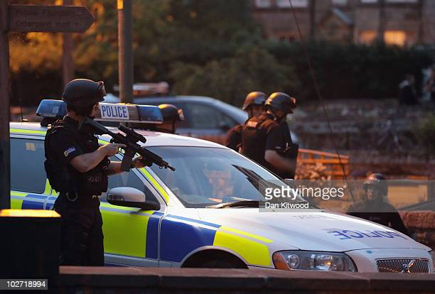 Police officers move in on a location as part of the ongoing search for Raoul Moat on July 8, 2010 in Rothbury, England. Police continue to search...