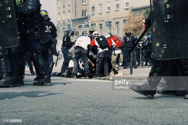 A police officers nockout by a cobblestone in front of the hospital of quot la PitiéSalpêtrièrequot Paris May the 1th of 2019
