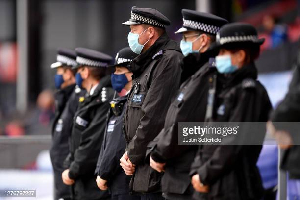 Police officers observe a minutes silence in memory of Police Sargent Matt Ratana, who lost his life in the line of duty prior to the Premier League...