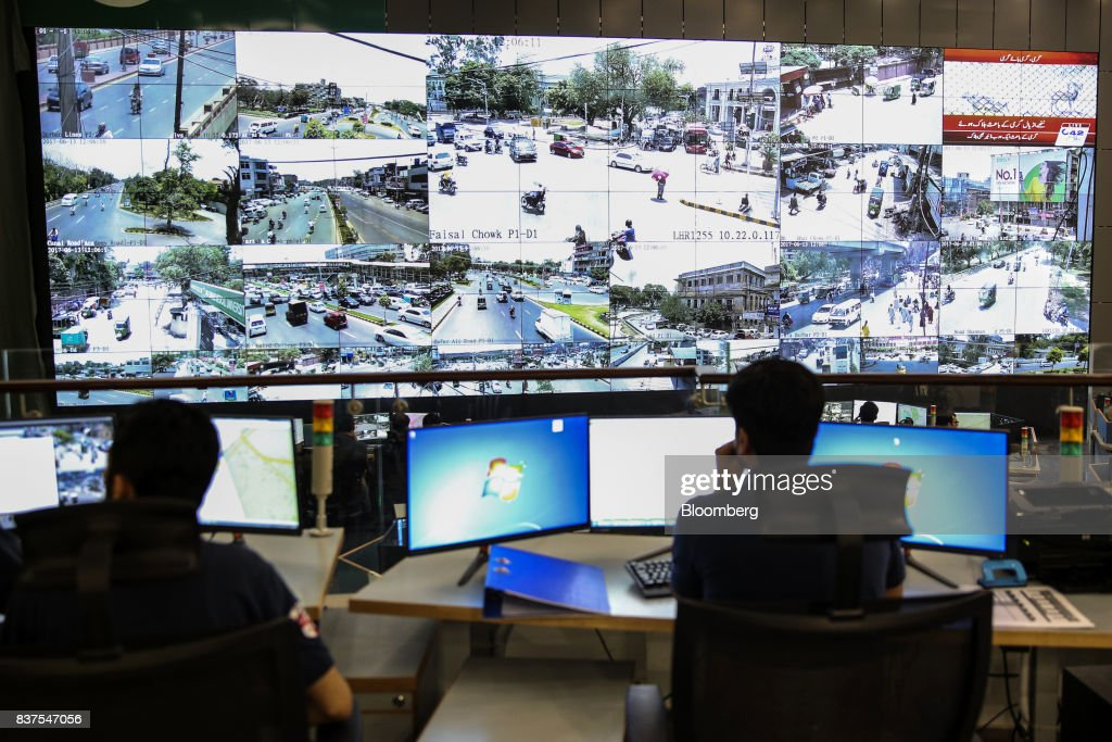 Police officers observe live video feeds from various locations around the city on monitors at the Punjab Police Integrated Command, Control and Communication Center (IC3) in Lahore, Pakistan, on Tuesday, June 13, 2017. While militants the U.S. identifies as terrorists find refuge in Pakistan, safety within the nation has improved dramatically after it launched a costly, now four-year long military crackdown on domestic insurgent and criminal groups, driving recent economic optimism. Photographer: Asad Zaidi/Bloomberg via Getty Images