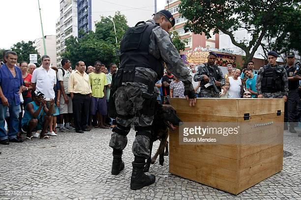 Police officers of a bomb squad work in the disarming of a box which supposedly contained a bomb at General Osorio square Ipanema on the fourth day...