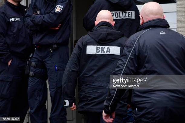 Police officers of the Federal Criminal Police Office the Bundeskriminalamt enter an apartment which was raided earlier by member of the GSG9 special...