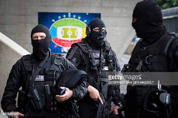 Police officers of the French Research and Intervention Brigade stand in the Parc des Princes stadium in Paris on June 21 2016 during the Euro 2016...