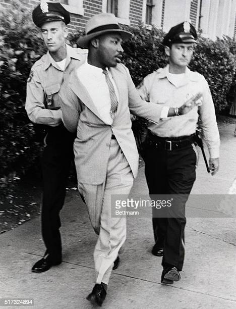 Police officers OM Strickland and JV Johnson apply force in arresting the Reverend Martin Luther King for loitering near a courtroom where one of his...
