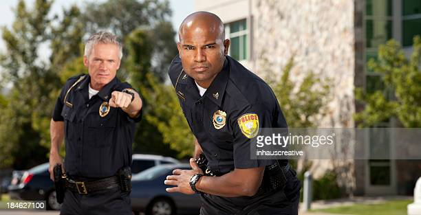 police officers on alert - aiming stock pictures, royalty-free photos & images