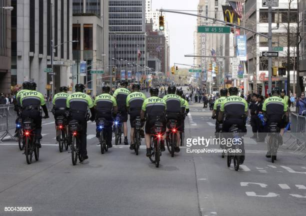 NYPD police officers on bicycles monitored thousands of New Yorkers and visiting demonstrators during a March On Tax Day to demand that President...