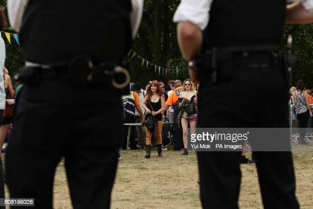 Police officers on duty as people arrive at the Field Day Festival held in Victoria Park in east London