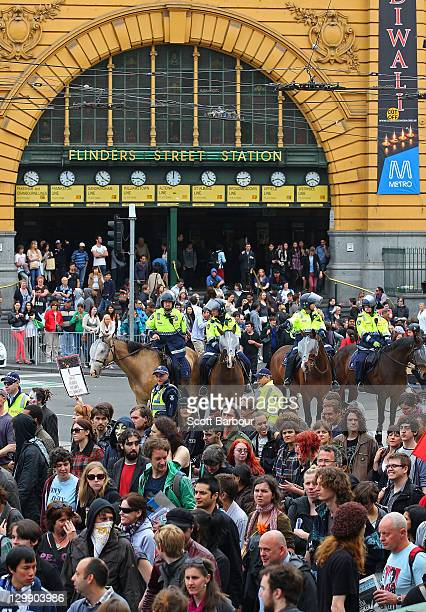 Police officers on horseback stand guard outside of Flinders Street Station as 'Occupy Melbourne' protestors demonstrate on October 22 2011 in...