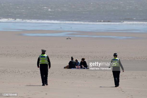 Police officers on patrol at Whitmore Bay on May 24 2020 in Barry United Kingdom The British government has started easing the lockdown it imposed...